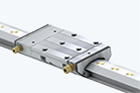 Linear guides with hydrostatic compact guide
